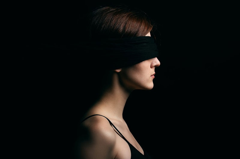Wearing blindfold in front of an adult video store
