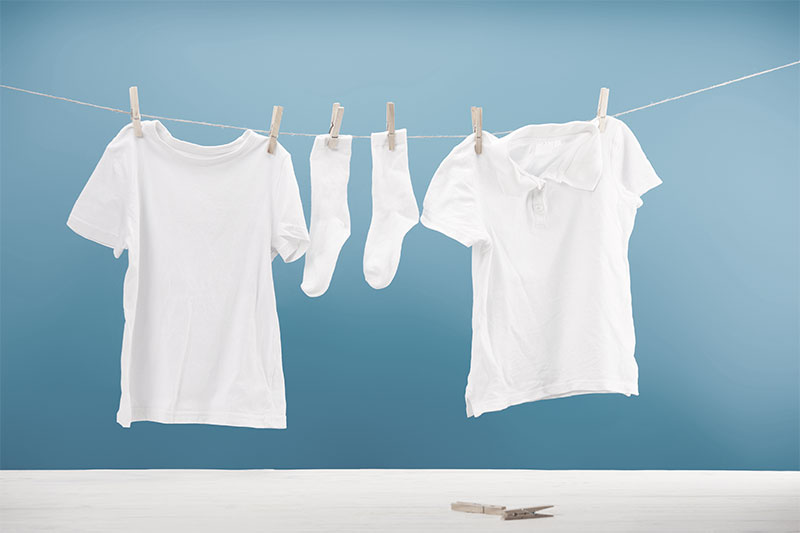 Dried Clothes By Using A Clothesline